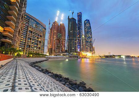 ABU DHABI, UAE - MARCH 25: Etihad Towers buildings in Abu Dhabi on March 25, 2014, UAE. Five towers complex with 74 floors is the third tallest building in Abu Dhabi.