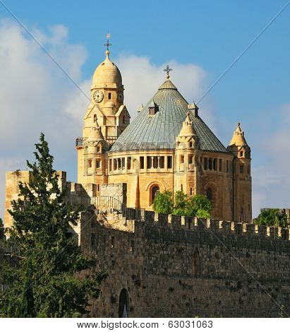 The Catholic Church of Dormition in Jerusalem. The morning sun illuminates the dome and the tower of the abbey.