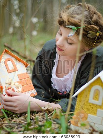 Girl Playing With Vintage Doll House