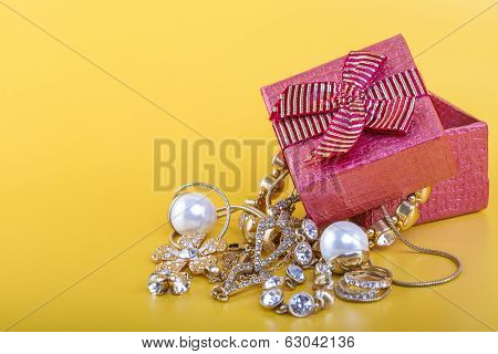Gold jewelry in red gift box