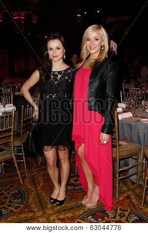 NEW YORK-APR 9: Figure skater Sasha Cohen and gymnast Nastia Liukin (R) attend the Food Bank for New York City's Can Do Awards Dinner Gala at Cipriani Wall Street on April 9, 2014 in New York City.