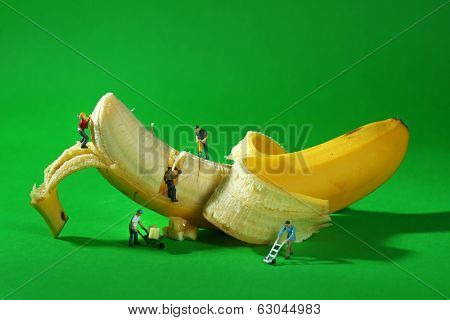 Miniature Construction Workers in Conceptual Food Imagery With Banana