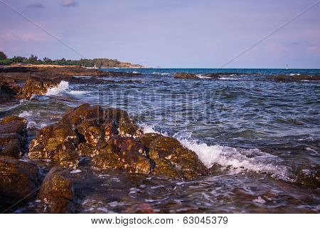 Waves Along The Rocky Shore