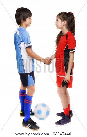 Two Children Boy And Girl Shaking Hands After Football Game