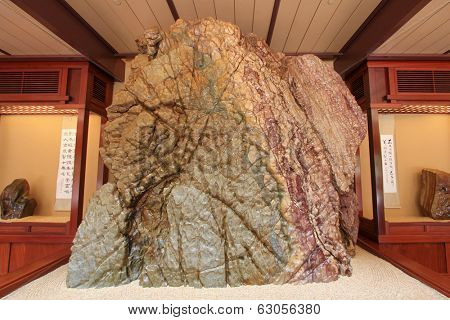 HONG KONG - JANUARY 2014 : A huge rock showing at the Rockery museum at Nan Lian Garden, in Diamond Hill, Hong Kong on January 1, 2014. The rock is from Red River of Guangxi Province in China