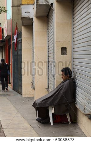 Person Sitting In Front Of Shop in Miraflores, Lima, Peru