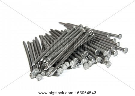 Pile Of Large Steel Nails On White