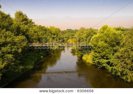 Suspension Bridge Through The River