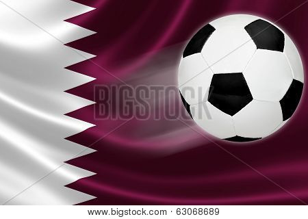 Soccer Ball Streaks Across Qatar's Flag