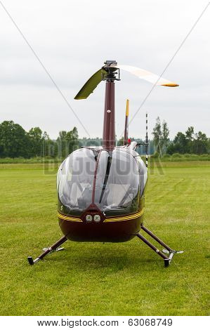 Small red private helicopter