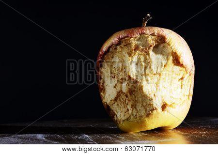 Bitten Apple On A Dark Background
