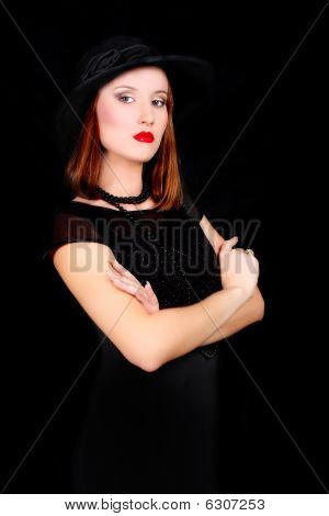 Elegant Woman In Black Dress And Hat Over Black