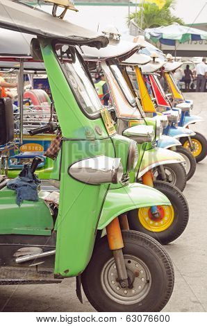 Tuk Tuks parked in a row, Bangkok