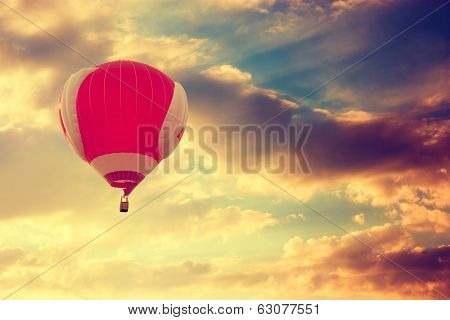 Hot Air Balloon Flying over Dramatic Sunset Sky poster
