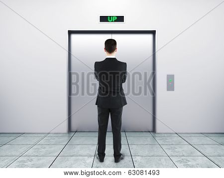Businessman And Elevator