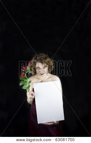 Woman holding red roses and sign