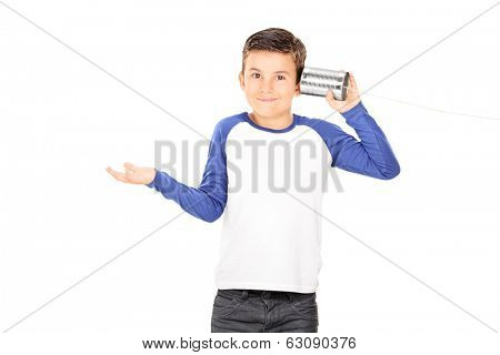 Little boy listening through a tin can phone isolated on white background