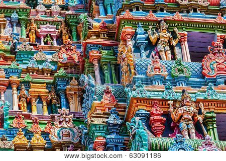 MADURAI, INDIA - FEBRUARY 16, 2013: Vintage retro hipster style image of Sculptures on Hindu temple gopura (tower) in Meenakshi Amman Temple - historic Hindu temple located in temple city Madurai