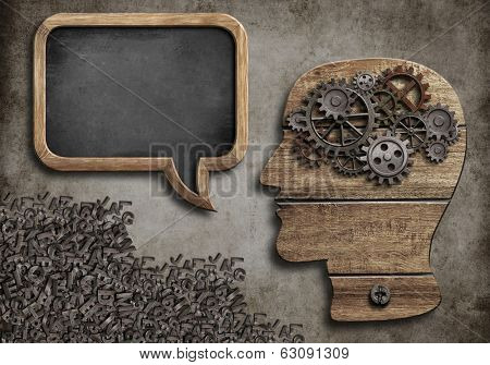 wooden head with speech bubble blackboard