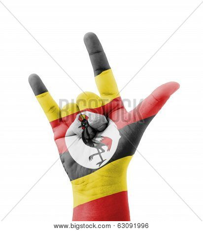 Hand Making I Love You Sign, Uganda Flag Painted, Multi Purpose Concept - Isolated On White Backgrou