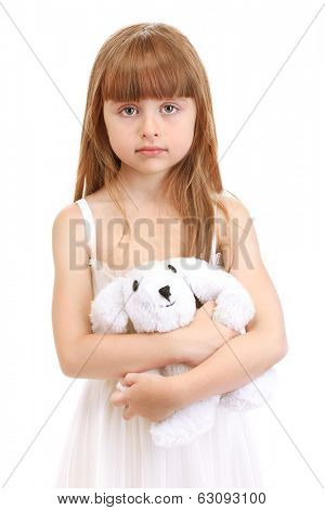 Portrait of beautiful cute girl with toy rabbit isolated on white