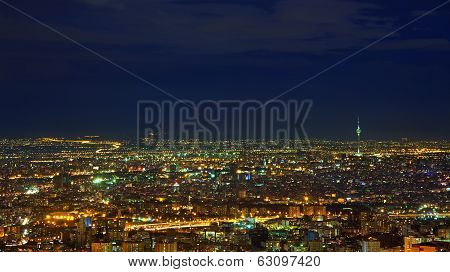 Illuminated Skyline Of Tehran Against Dark Blue Sky