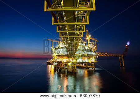 Oil and gas platform in sunset or sunrise time.