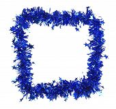 Christmas blue tinsel with stars as frame.