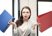business concept - unsure thinking or wondering woman with folder