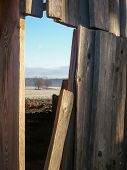 picture of orifice  - Wooden wall allows view over rural wideness - JPG