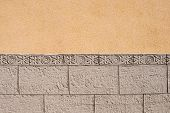image of tile cladding  - Ornamental wall cladding using granite bricks with floral motives - JPG