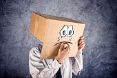 Businessman With Cardboard Box On His Head And Sad Face Expression