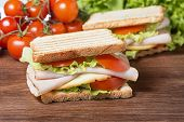 foto of nic  - delicious sandwiches with chicken breast salad cheese and tomatoes - JPG