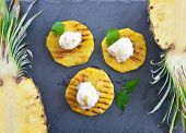 foto of vanilla  - Grilled pineapple with scoops of vanilla ice cream - JPG