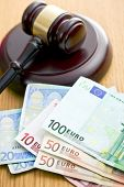 judge gavel and euro currency on wooden table