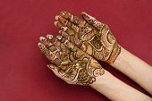 beautifully decorated indian hands with mehandi typically done for weddings