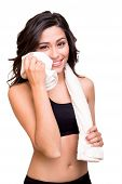 pic of transpiration  - Fitness woman wiping sweat with a towel - JPG