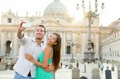 Tourists couple by Vatican city and St. Peter's Basilica church in Rome. Happy travel woman and man