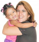 Mother giving a strong hug to her small multiracial daughter isolated on white