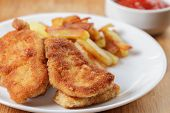 picture of southern fried chicken  - fried chicken nuggets with fries close up - JPG
