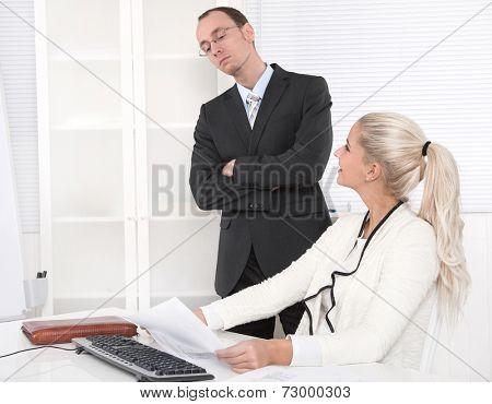 Bullying: arrogant boss control his secretary.