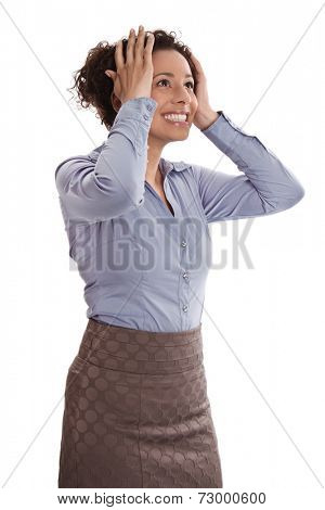 Successful businesswoman is relieved and excited with head between hands - Stock Photo