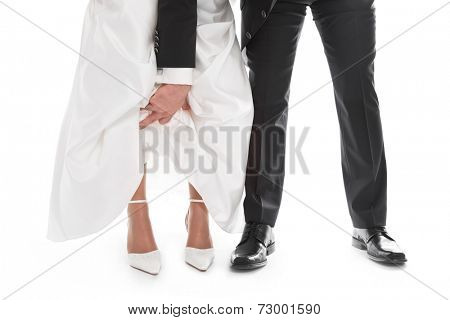Groom is showing bride's feet, shoe, dress - wedding, marriage.