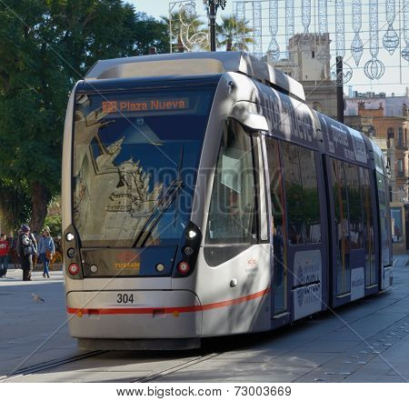 SEVILLE, SPAIN - JANUARY 3, 2013: Modern tram MetroCentro on the line. The tramway serves the city center and began operating in October 2007