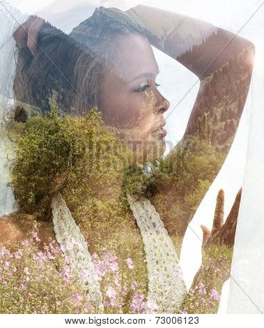 Double exposure portrait of beautiful young lady combined with photograph of mountainous landscape