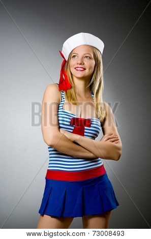 Female sailor against grey background
