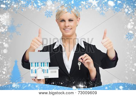 Composite image of multitasking estate agent against snow