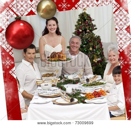 Family celebrating Christmas dinner with turkey against christmas themed page