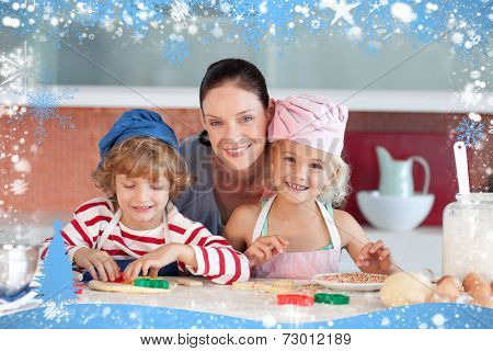 Happy mother baking with her children against snow
