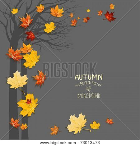 Silhouette of a tree and falling leaves with copy space